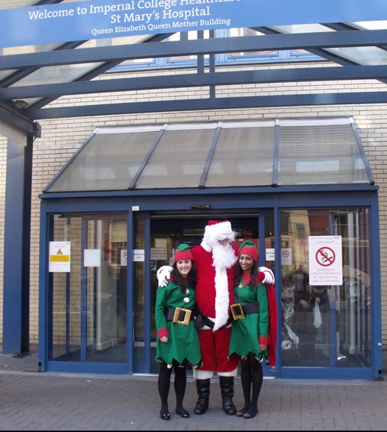 Cargiant Santa and his elves outside St Mary's, Paddington. 2014